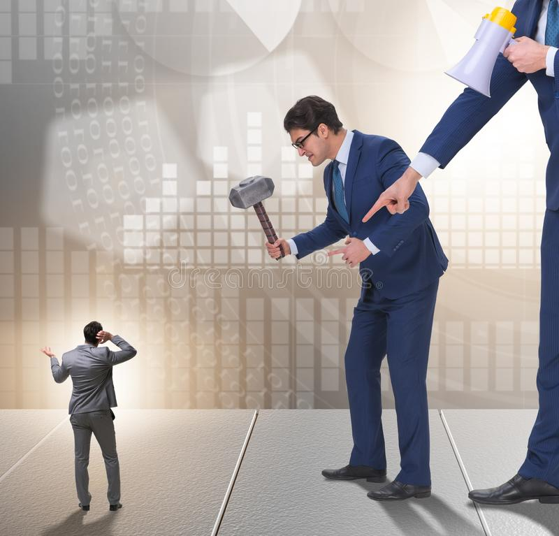 Bad angry boss harassing employee in business concept. The bad angry boss harassing employee in business concept stock photos