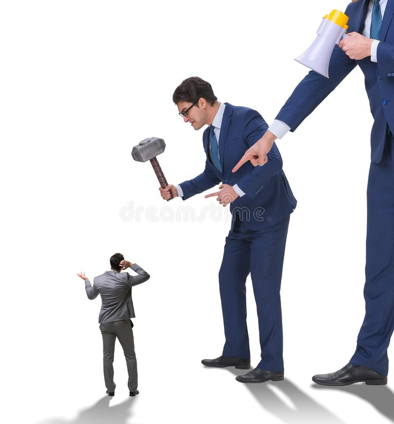 Bad angry boss harassing employee in business concept. The bad angry boss harassing employee in business concept royalty free stock images