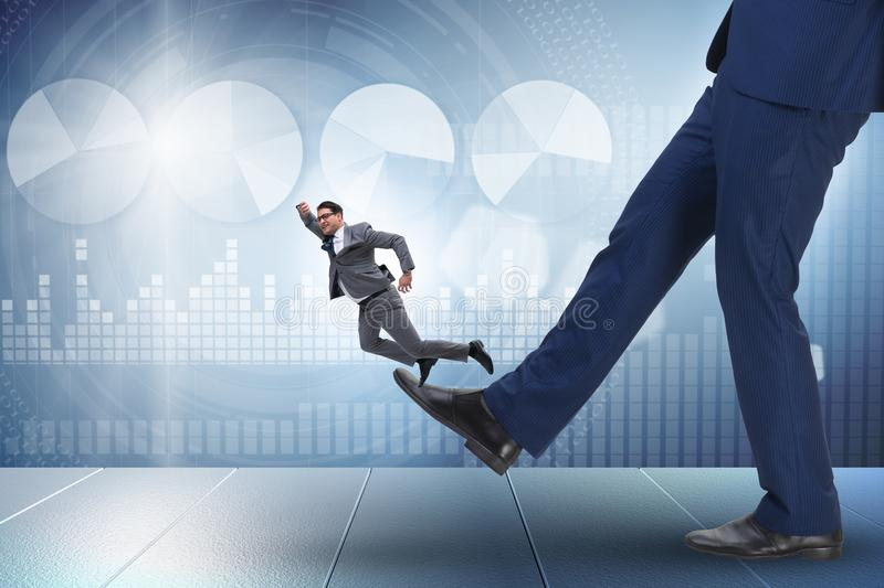 The bad angry boss kicking employee in business concept. Bad angry boss kicking employee in business concept royalty free stock photos