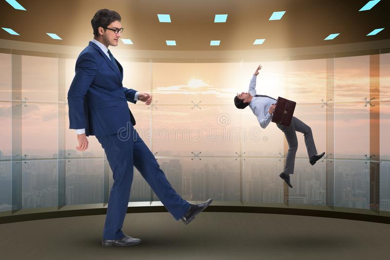 The bad angry boss kicking employee in business concept. Bad angry boss kicking employee in business concept stock photo