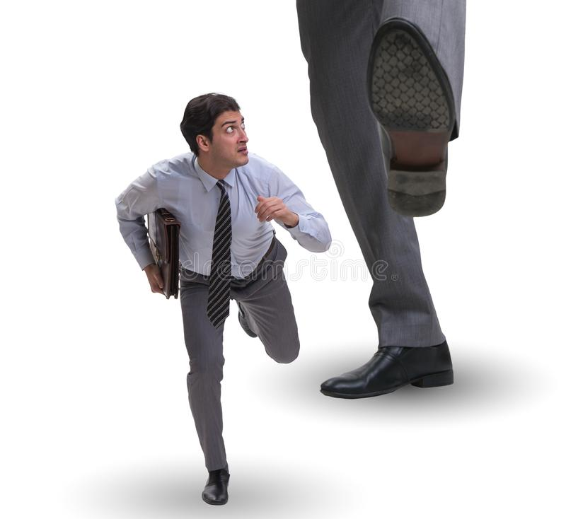 Bad angry boss kicking employee in business concept. The bad angry boss kicking employee in business concept royalty free stock image