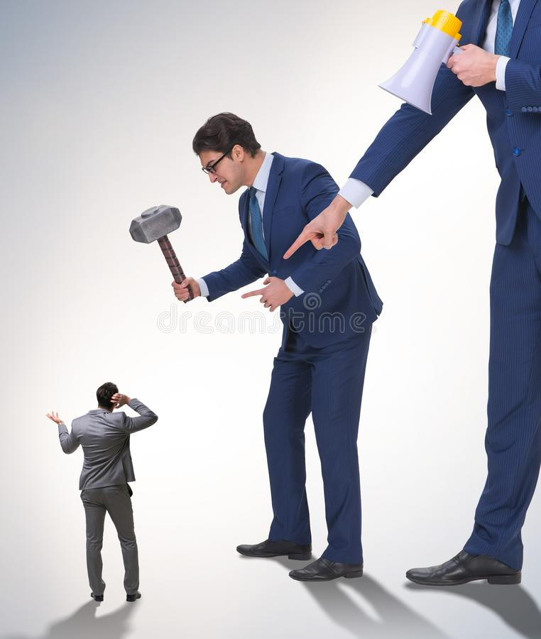 Bad angry boss shouting at employee with loudspeaker. The bad angry boss shouting at employee with loudspeaker stock photo