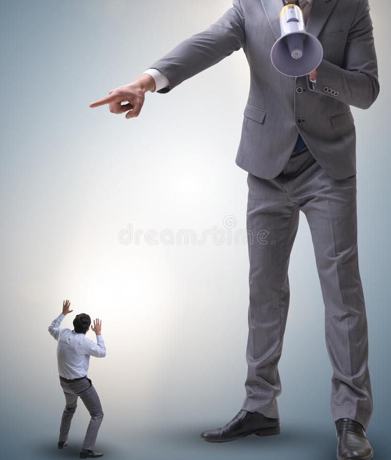 Bad angry boss shouting at employee with loudspeaker. The bad angry boss shouting at employee with loudspeaker royalty free stock photo