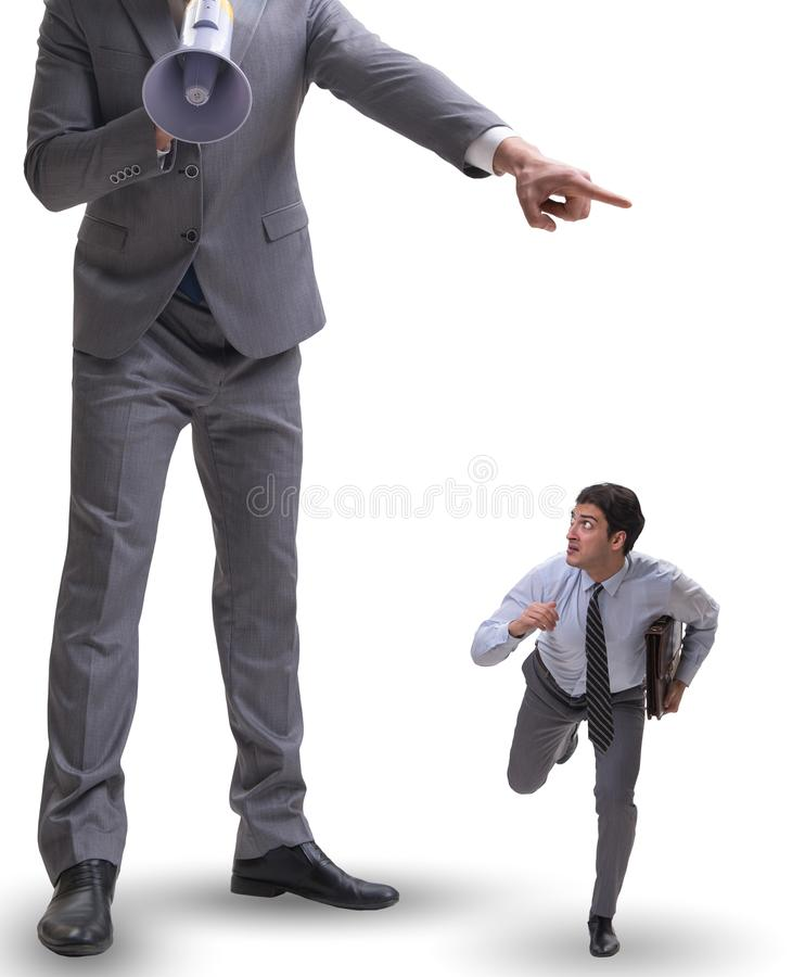 The bad angry boss shouting at employee with loudspeaker. Bad angry boss shouting at employee with loudspeaker stock photo