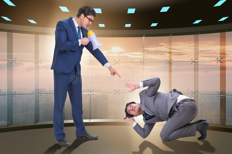 The bad angry boss shouting at employee with loudspeaker. Bad angry boss shouting at employee with loudspeaker stock image