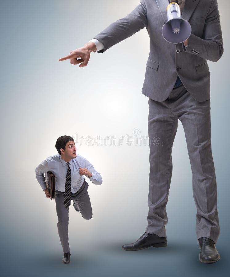 Bad angry boss shouting at employee with loudspeaker. The bad angry boss shouting at employee with loudspeaker royalty free stock photos