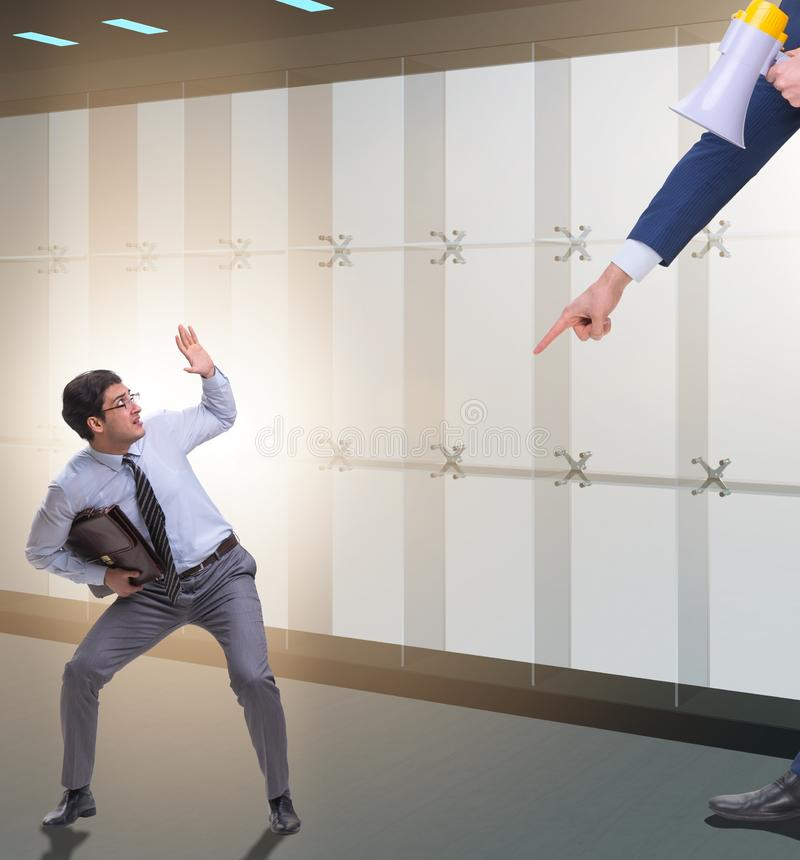 The bad angry boss shouting at employee with loudspeaker stock photo