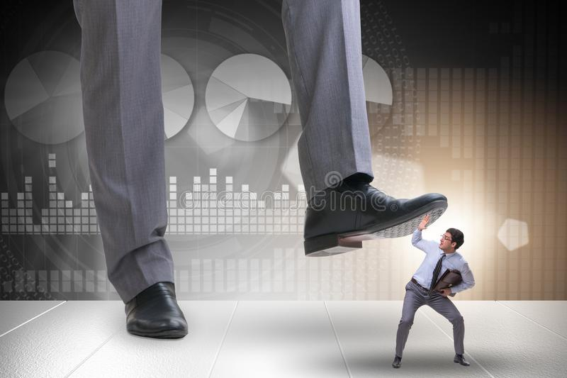 The bad angry boss stamping on employee in business concept. Bad angry boss stamping on employee in business concept stock photos
