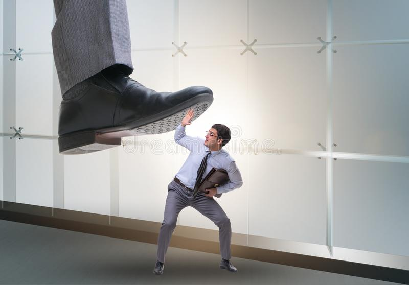 Bad angry boss stamping on employee in business concept. The bad angry boss stamping on employee in business concept stock images