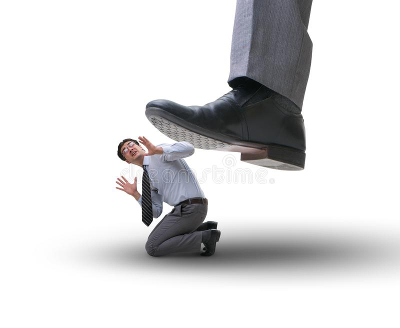 Bad angry boss stamping on employee in business concept. The bad angry boss stamping on employee in business concept royalty free stock photography