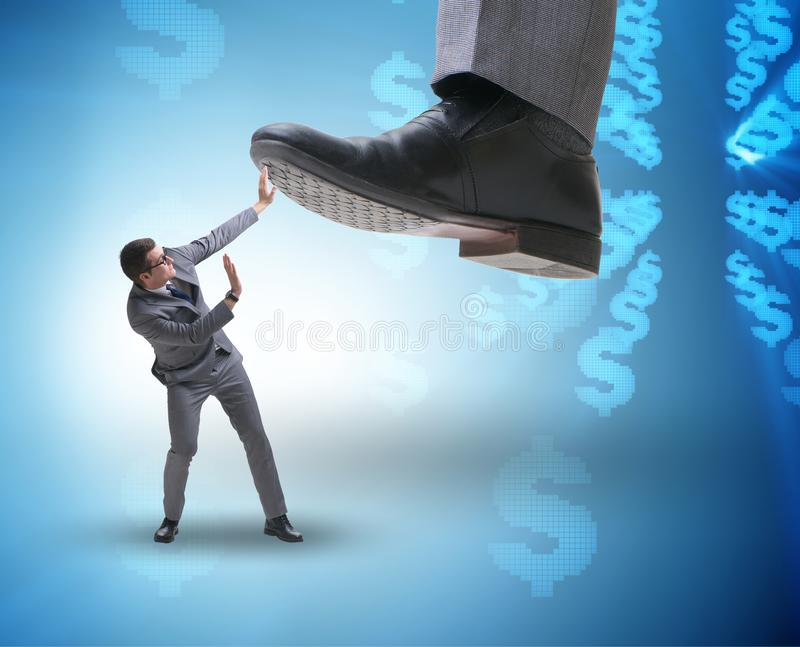 Bad angry boss stamping on employee in business concept. The bad angry boss stamping on employee in business concept royalty free stock images