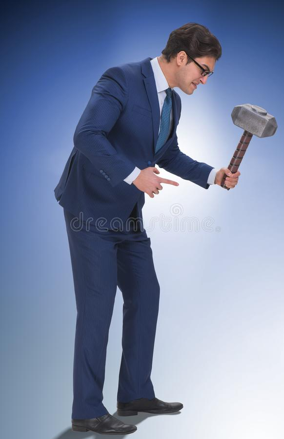 Bad angry boss threatening employee with hammer. The bad angry boss threatening employee with hammer stock photography