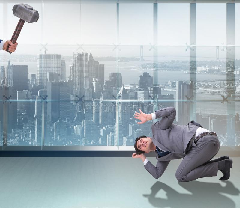 Bad angry boss threatening employee with hammer. The bad angry boss threatening employee with hammer stock photos
