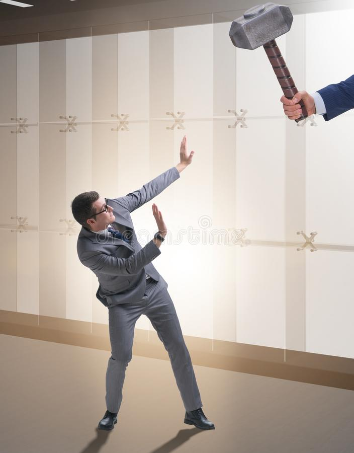 Bad angry boss threatening employee with hammer. The bad angry boss threatening employee with hammer royalty free stock image
