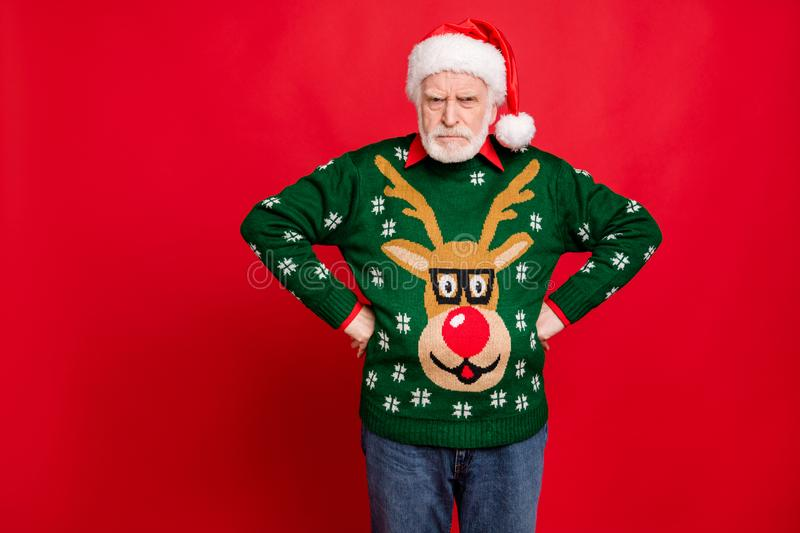 Bad angry santa claus for naughty kids concept. Portrait of sullen grumpy old man in x-mas headwear have conflict on. Christmas time, wear fun reindeer decor royalty free stock photo