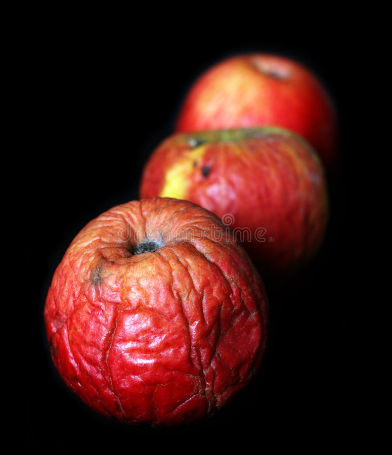 Bad apples. Close up on a dark background royalty free stock photography