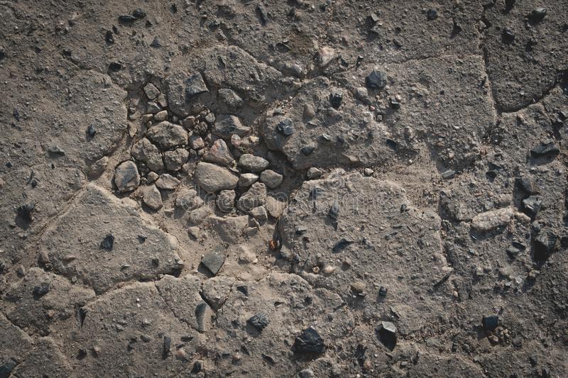 Bad asphalt road, pit on the road royalty free stock photography