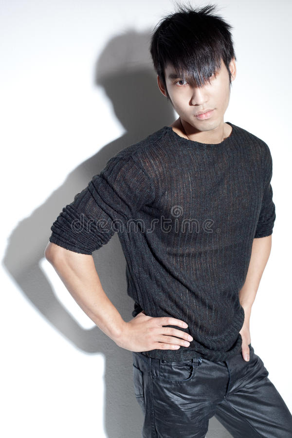 Download Bad Boy Chinese Man In Black Staring With Attitude Stock Photo - Image: 10956546