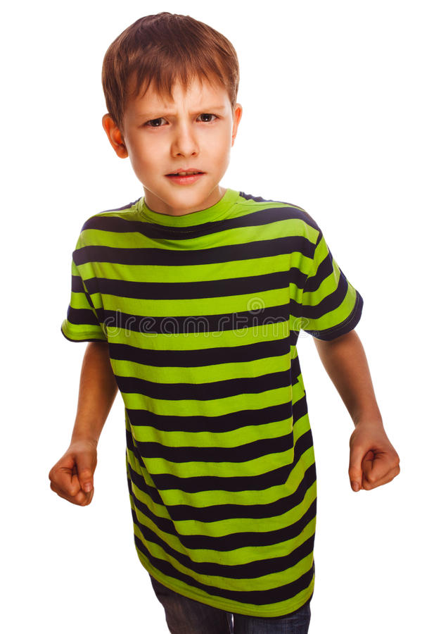 Bad child boy blond bully angry aggressive fights. In striped green shirt isolated on white background stock image