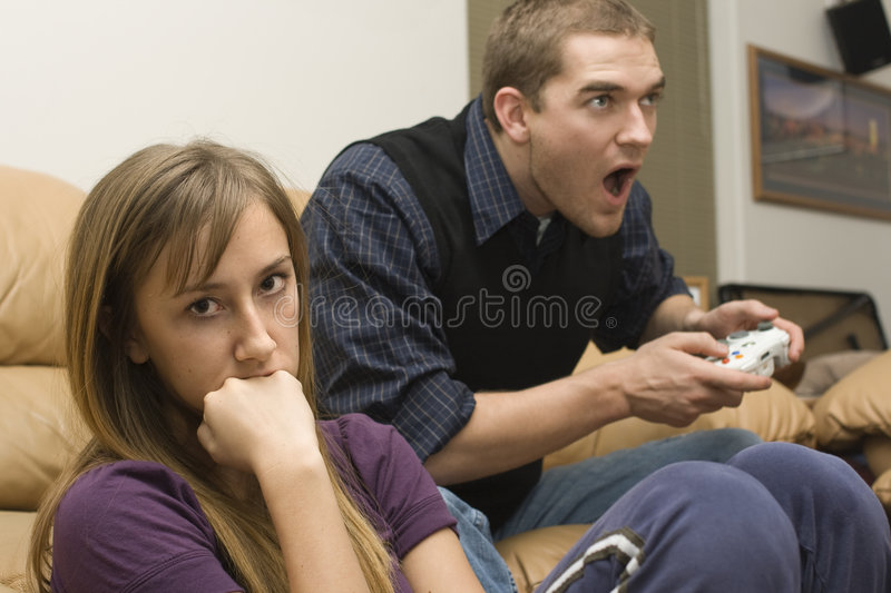 Really Bad Date. A young man plays video games while his date watches