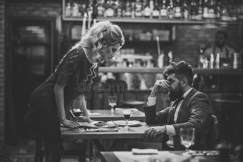 Bad date.Young couple in restaurant having problems and crisis stock image