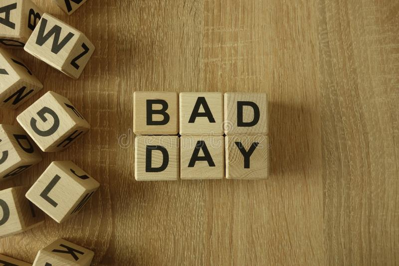 Bad day text from wooden blocks. On desk stock photo
