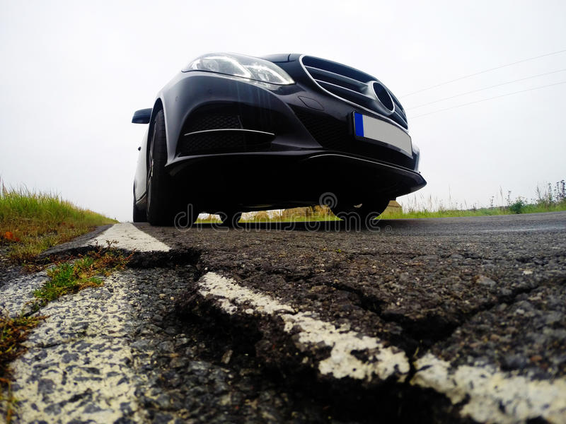 Bad, destructed road and car royalty free stock images