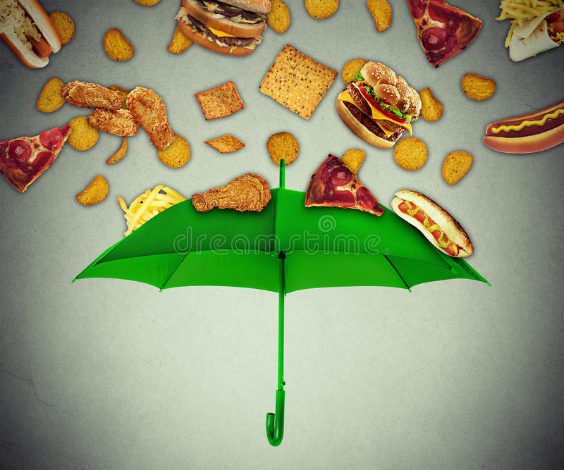 Bad diet protection concept greasy fatty fast food falling down. Bad diet protection food concept with group of greasy fatty fast food falling down like rain and royalty free stock photography