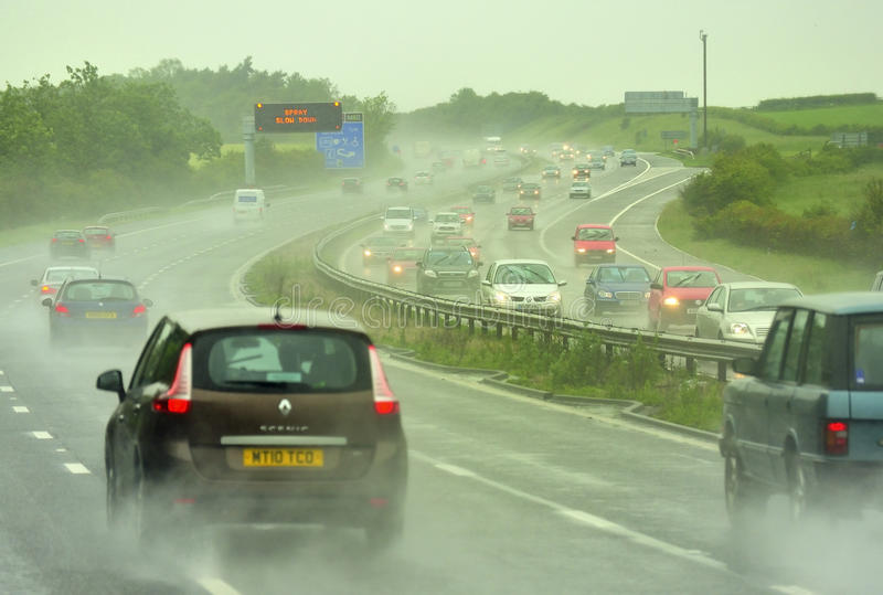 Bad driving weather M6. Torrential rain and spray, on the M6 motorway, north of Birmingham, England royalty free stock image
