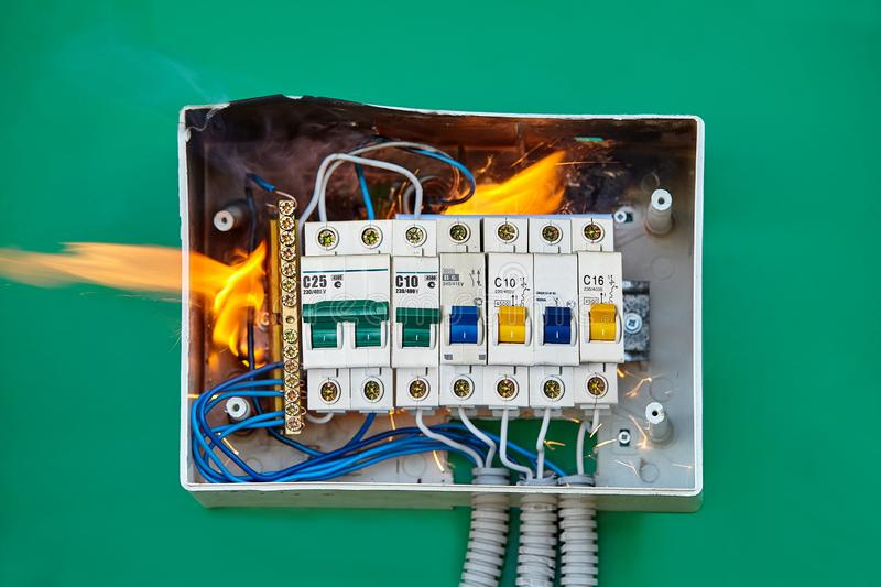 Bad electric switchboard caused fire in apartment. Electrical problems, improper electric wiring present a fire hazard. Loose wires caused fire inside electrical stock image