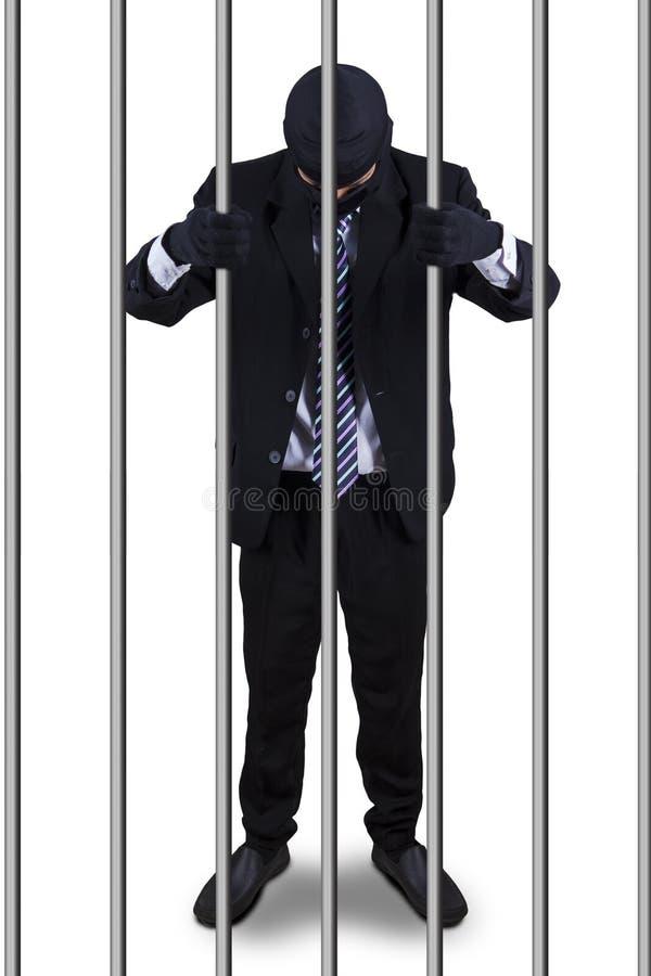 Bad entrepreneur in the prison stock photography