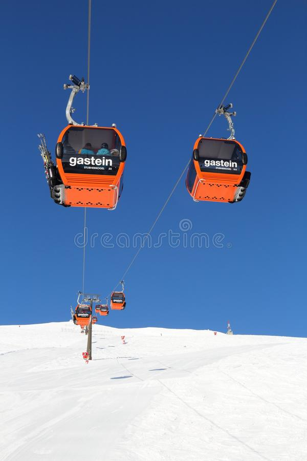 Austria Ski Amade. BAD GASTEIN, AUSTRIA - MARCH 9, 2016: People ride gondolas of cable car in Bad Gastein. It is part of Ski Amade, one of largest ski regions in royalty free stock photo