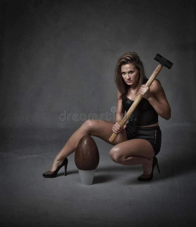 Bad girl with easter egg. Girl in dark background ready for easter holiday stock images