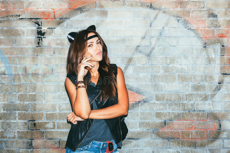 Bad girl with leather cat ears. Urban scene. Outdoor lifestyle portrait stock images