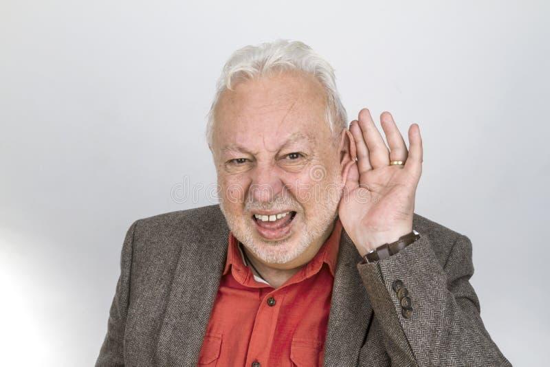 Bad hearing senior stock image