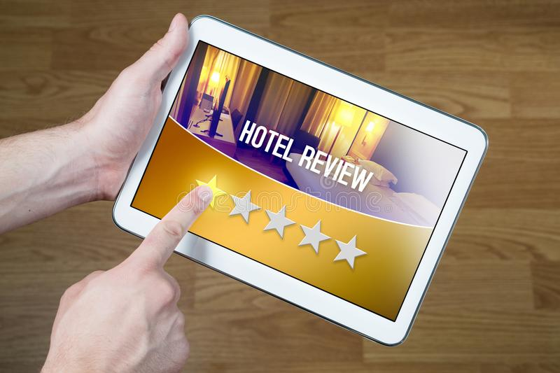 Bad hotel review. Disappointed and dissatisfied customer. Bad hotel review. Disappointed and dissatisfied customer giving terrible rating with tablet on an stock photo
