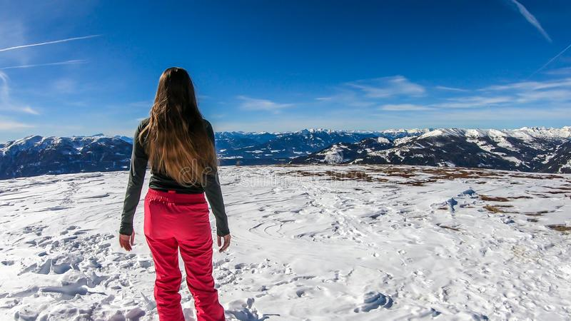Bad Kleinkirchheim - A girl having fun in the snow with beautiful view royalty free stock photography