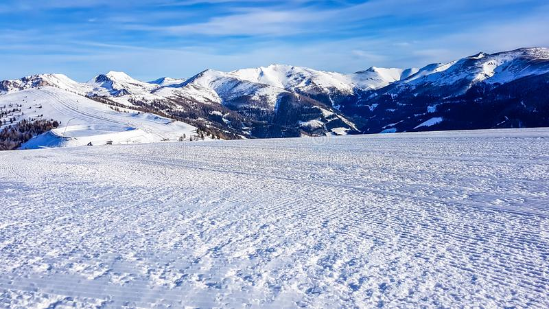 Bad Kleinkirchheim - Winter wonderland in the alps. View on fog-covered valley in Bad Kleinkirchheim, Austria. Big ski resort. The slopes are perfectly gravelled stock image