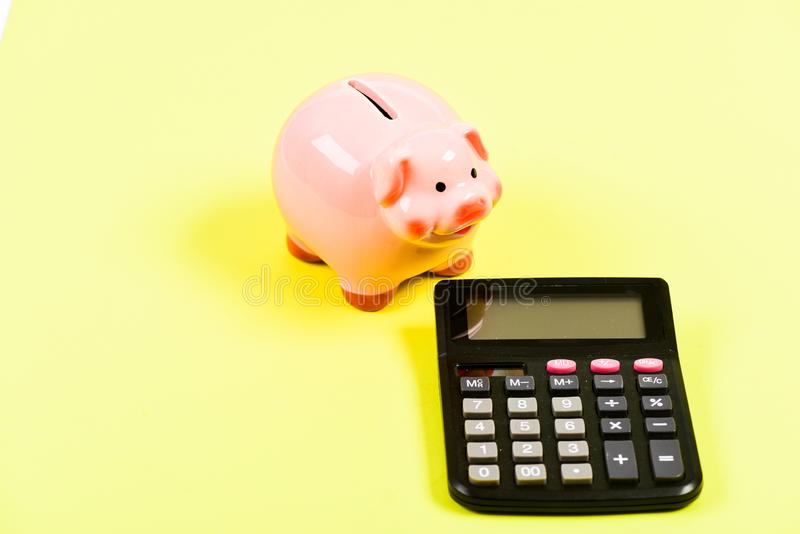 Bad luck. moneybox with calculator. Piggy bank. planning and counting budget. bookkeeping. financial problem. money stock photo