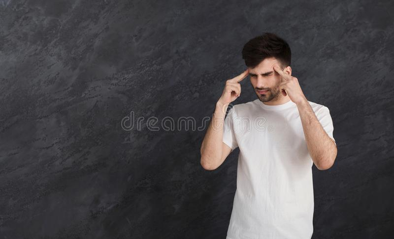 Stressed man whit bad memory trying to concentrate stock photo