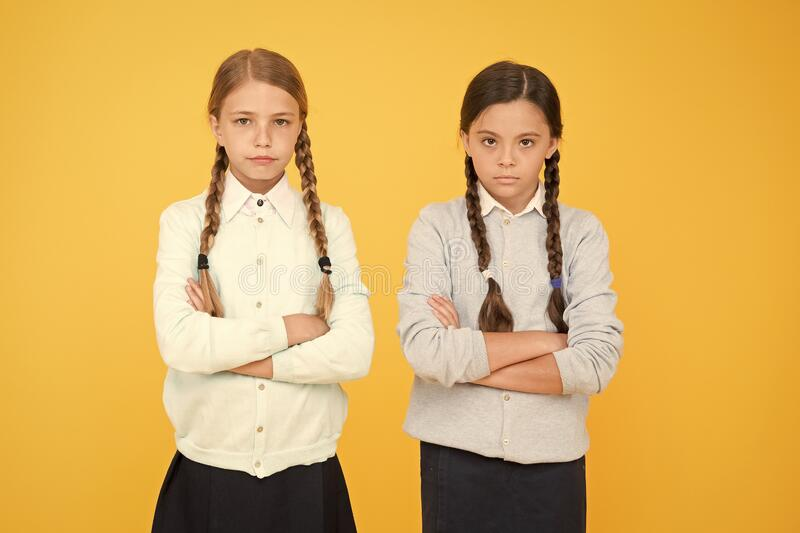 Bad mood concept. School friendship. Support and friendship. Problem relations. Friendly relationship. Friendship goals. Cute school girls classmates. First royalty free stock photos