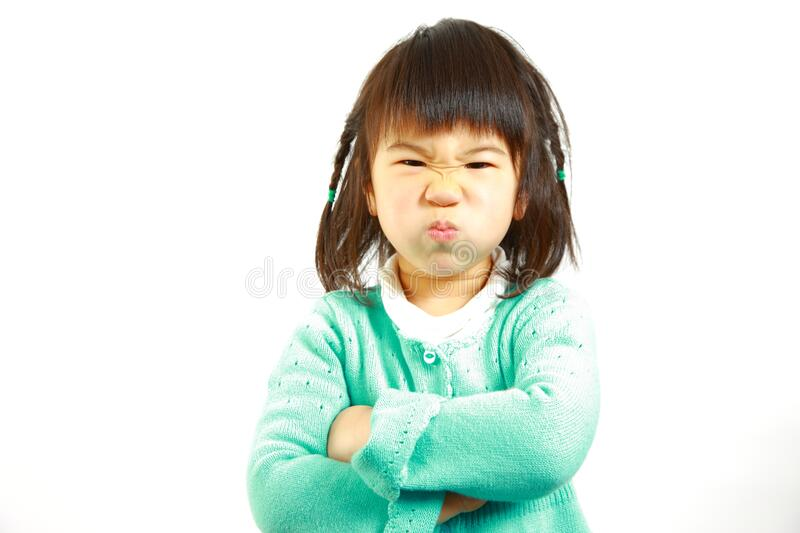 Bad mood Japanese little girl. Concept shot of Japanese people stock images