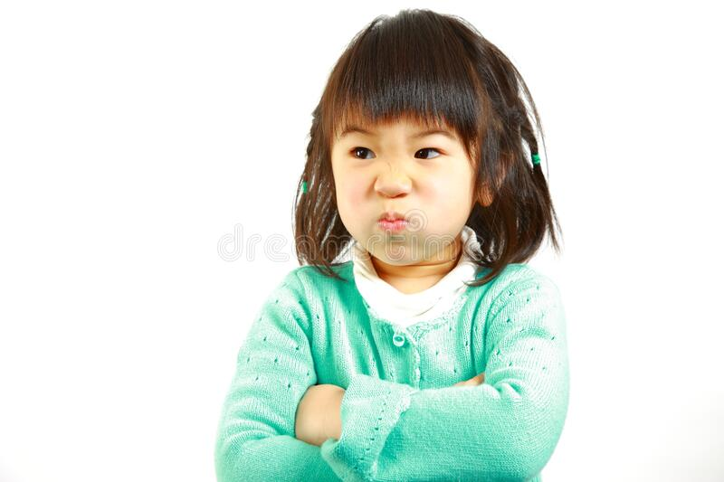 Bad mood Japanese little girl. Concept shot of Japanese people stock photography
