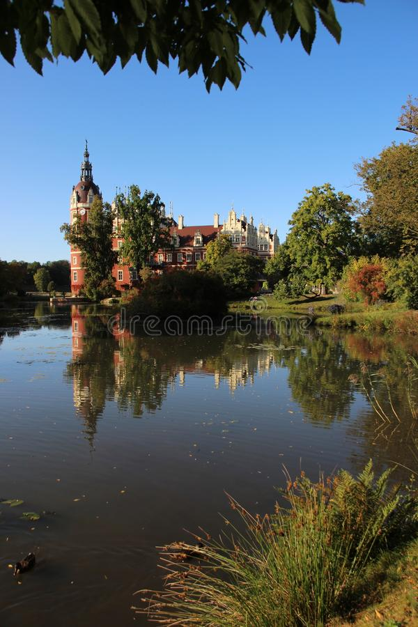 Bad Muskau Castle In Germany. History Building. Bad Muskau Palace And Reflection With Warm Sunlight In Saxony Germany stock photo