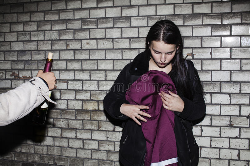 Bad neighborhood influence concept: lifestyle teenage with alcohol abuse, drinking vine at night, real junky teen girl royalty free stock photo