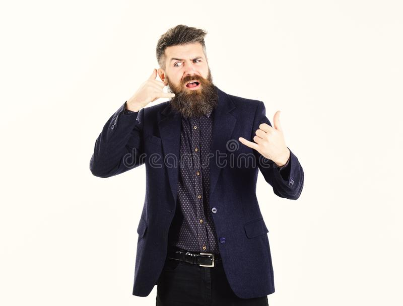 Bad phone service. Bearded man shows call me gesture. Hipster with long beard and unsatisfied face. Mature man wears stock photos