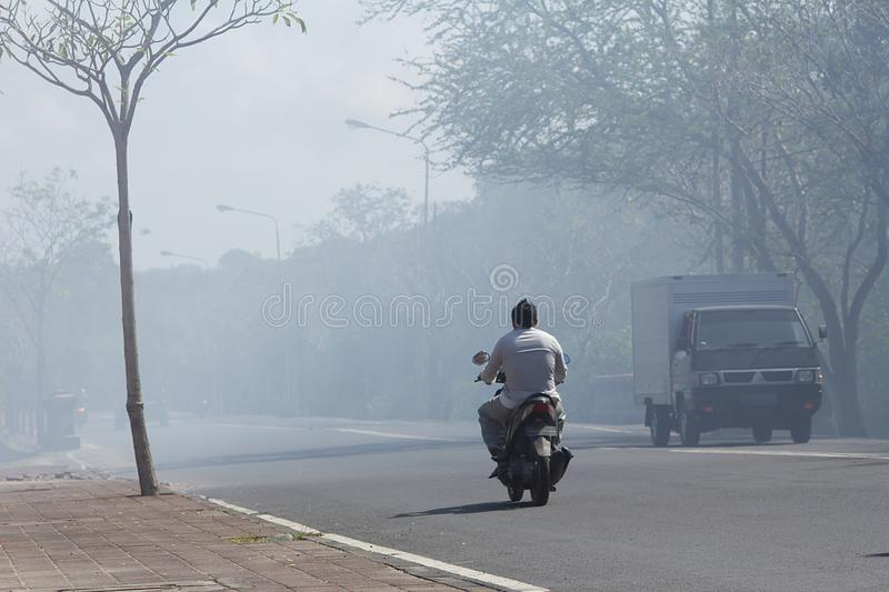 Bad polution. From vehicle emission reducing visibility endanger riders royalty free stock photography