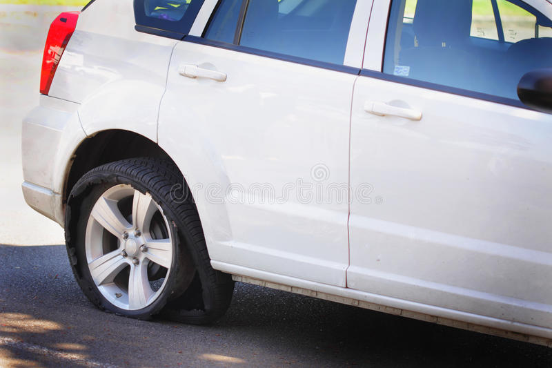 Bad problem stock image image of flat inconvenient 30873701 a white car on the road with a badly shredded flat rear tire thecheapjerseys Gallery