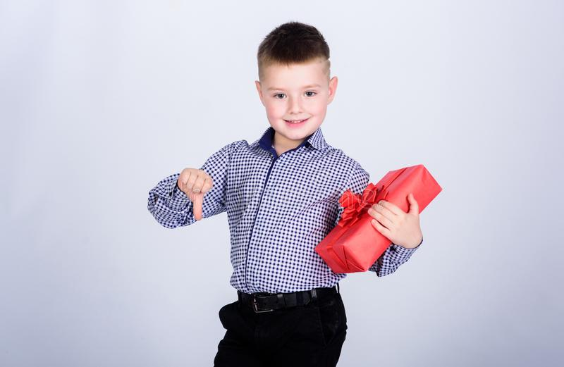 Bad quality. Birthday party. little boy with valentines day gift. Shopping. Boxing day. New year. shop assistant. Happy. Childhood. happy child with present box stock image