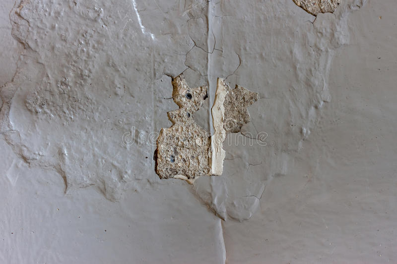 Bad quality painted cracked concrete floor. Bad quality painted grey cracked concrete floor background stock photos